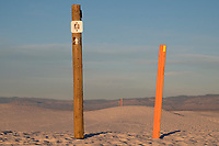Trailmarkers show the way along the Backcountry Camping Trail at White Sands National Monument near Alamogordo, New Mexico, USA, on Sat., Dec. 30, 2017.