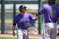 Colorado Rockies shortstop LJ Hatch (38) is congratulated by Jacob Bosiokovic (21) after scoring a run during an Extended Spring Training game against the Chicago Cubs at Sloan Park on April 17, 2018 in Mesa, Arizona. (Zachary Lucy/Four Seam Images)