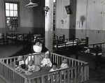 September 28, 1948 : Tokyo, Japan - Five babies were at a fence of The Tokyo Maria relief orphanage in September 28, 1948, Tokyo, Japan. The first Baby boom in Japan is 1947 - 1949 which just after end of World War 2. This generation called 'Dankainosedai'. (Photo by Kingendai Photo Library/AFLO)
