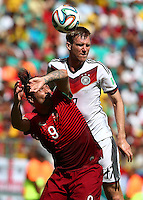 Per Mertesacker of Germany rises above Hugo Almeida of Portgual to head the ball