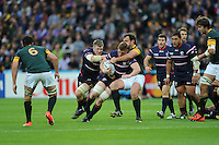 07 October 2015: John Quill of USA is slowed down by Bismarck Du Plessis of South Africa as Louis Stanfill of USA supports during Match 31 of the Rugby World Cup 2015 between South Africa and USA - Queen Elizabeth Olympic Park, London, England (Photo by Rob Munro/CSM)