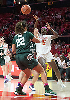 COLLEGE PARK, MD - FEBRUARY 03: Ashley Owusu #15 of Maryland slots a pass over Moira Joiner #22 of Michigan State during a game between Michigan State and Maryland at Xfinity Center on February 03, 2020 in College Park, Maryland.