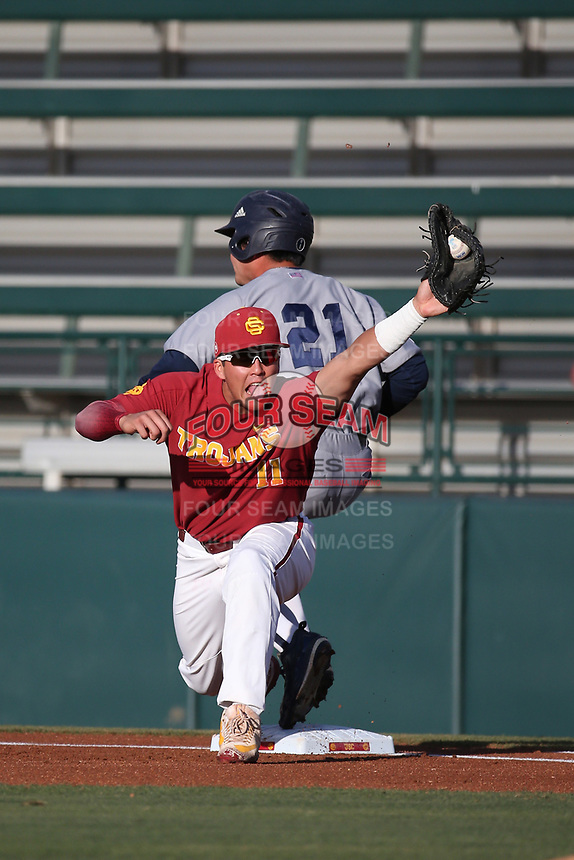Lars Nootbaar (11) of the Southern California Trojans catches the throw as Mikey Duarte (21) of the UC Irvine Anteaters beats the throw to first base during a game at Dedeaux Field on April 18, 2017 in Los Angeles, California. UC Irvine defeated Southern California, 14-3. (Larry Goren/Four Seam Images)