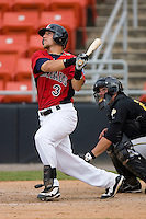 Mike Bianucci #3 of the Hickory Crawdads connects for a home run in the 9th inning at L.P. Frans Stadium June 21, 2009 in Hickory, North Carolina. (Photo by Brian Westerholt / Four Seam Images)