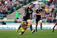 Ben Lam of New Zealand escapes from the tackle of Tom Lucas of Australia during Day Two of the iRB Marriott London Sevens at Twickenham on Sunday 11th May 2014 (Photo by Rob Munro)