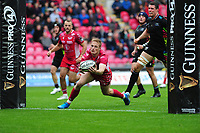 Johnny McNicholl of Scarlets scores his sides seventh try during the Guinness Pro14 Round 02 match between the Scarlets and Zebre Rugby at the Parc Y Scarlets Stadium in Llanelli, Wales, UK. Saturday 12 October 2019