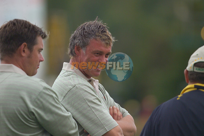 Darren Clarke and Lee Westwood share a laugh with Des Smyth on the 18th green during the Morning Fourball on Day1 of the 2006 Ryder Cup at The K Club 21st September 2006.(Photo Eoin Clarke/Newsfile)