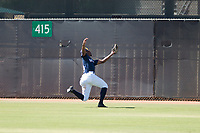 Milwaukee Brewers center fielder Joe Gray (9) catches a fly ball during an Instructional League game against the Los Angeles Dodgers at Maryvale Baseball Park on September 24, 2018 in Phoenix, Arizona. (Zachary Lucy/Four Seam Images)