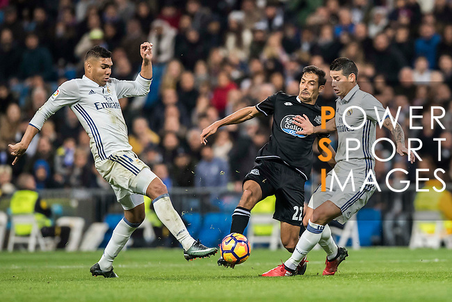 Celso Borges Mora (c) of RC Deportivo La Coruna battles for the ball with Carlos Henrique Casemiro (l) and James Rodriguez of Real Madrid in action during the La Liga match between Real Madrid and RC Deportivo La Coruna at the Santiago Bernabeu Stadium on 10 December 2016 in Madrid, Spain. Photo by Diego Gonzalez Souto / Power Sport Images