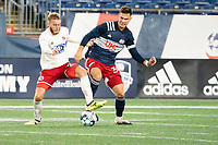 FOXBOROUGH, MA - OCTOBER 16: Alex Bruce #28 of North Texas SC and Collin Verfurth #35 of New England Revolution II compete for the ball during a game between North Texas SC and New England Revolution II at Gillette Stadium on October 16, 2020 in Foxborough, Massachusetts.