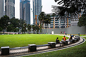 Joggers stretching at the KLCC park in Kuala Lumpur, Malaysia.