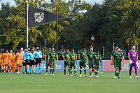 LAKE BUENA VISTA, FL - JULY 18: The starting XI from Portland Timbers, Houston Dynamo and referees enter the field wearing masks during a game between Houston Dynamo and Portland Timbers at ESPN Wide World of Sports on July 18, 2020 in Lake Buena Vista, Florida.