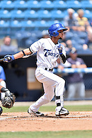 Asheville Tourists shortstop Carlos Herrera (4) swings at a pitch during a game against the Charleston RiverDogs at McCormick Field on July 10, 2016 in Asheville, North Carolina. The Tourists defeated the RiverDogs 4-2. (Tony Farlow/Four Seam Images)