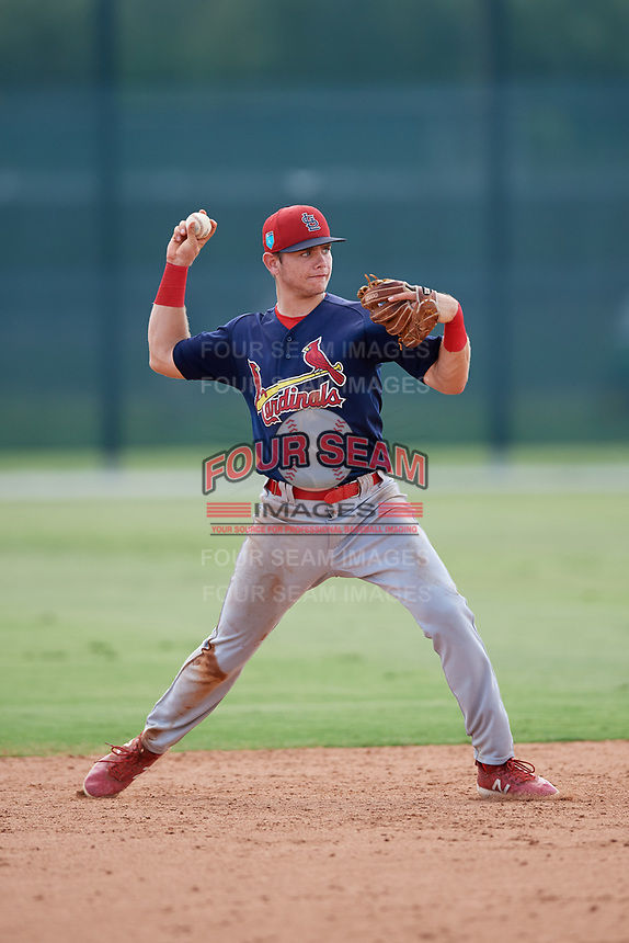 GCL Cardinals shortstop Mateo Gil (16) throws to first base during a game against the GCL Marlins on August 4, 2018 at Roger Dean Chevrolet Stadium in Jupiter, Florida.  GCL Marlins defeated GCL Cardinals 6-3.  (Mike Janes/Four Seam Images)
