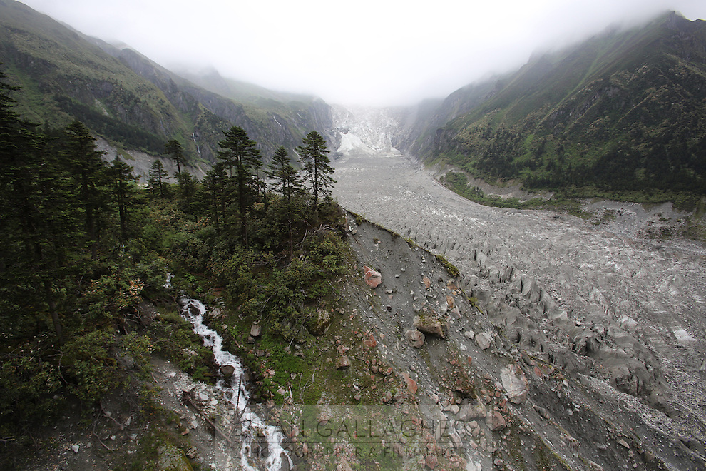 The Hailuo valley and its glacier, on the eastern side of Mt. Gongga in the Tibetan region of Garze on the southeast edge of the Tibetan Plateau. The glacier has retreated over 2 km during the 20th century alone. Since the Little Ice Age, studies have revealed that the total monsoonal glacier coverage in the southeast of the Tibetan Plateau has decreased by as much as 30 percent, causing alarm in scientific circles.