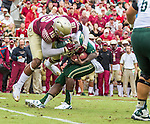 Florida State linebacker Jacob Pugh sacks South Florida quarterback Quinto Flowers in the first half of an NCAA college football game in Tallahassee, Fla., Saturday, Sept. 12, 2015. The FSU Seminoles defeated the South Florida Bulls 34-14.