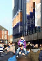 Pictured: A father and his young daughter walk outside Goodison Park stadium. Sunday 16 February 2014<br /> Re: FA Cup, Everton v Swansea City FC at Goodison Park, Liverpool, UK.