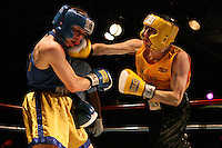 NY Daily News Golden Gloves bout at the Copacabana in Manhattan, NY.  Robert Mannino, Gold, right, vs. Michael Rey, Blue, left, in the 132-Open division.  Rey won via a decision.