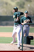 Michael Ynoa. Oakland Athletics minor league pitcher, throws a live batting practice session at the A's complex at Papago Park, Phoenix, AZ - 03/12/2010. It was Ynoa's first live BP session in Arizona after sitting out the entire 2009 season due to injury. Ynoa signed for a bonus of $4.25 million in July 2008 shortly after turning 16. Pitching coach Jimmy Escalante is in the background..Photo by:  Bill Mitchell/Four Seam Images.