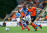 St Johnstone v Dundee United....01.09.12      SPL  .Gregory Tade closed down by Sean Dillon and Richie Ryan.Picture by Graeme Hart..Copyright Perthshire Picture Agency.Tel: 01738 623350  Mobile: 07990 594431
