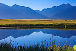 Mission Mountains and reflections in a pond on the Ninepipes Wildlife Refuge in western Montana