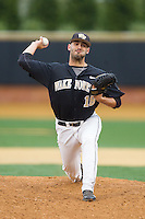 Wake Forest Demon Deacons relief pitcher Aaron Fossas (18) delivers a pitch to the plate against the Florida State Seminoles at Wake Forest Baseball Park on April 19, 2014 in Winston-Salem, North Carolina.  The Seminoles defeated the Demon Deacons 4-3 in 13 innings.  (Brian Westerholt/Four Seam Images)