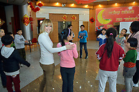 "Swiss singer and TV presenter Francine Jordi play with students while visiting ""SOS Kinderdorf"" in Tianjin, China. 22-Mar-2016"