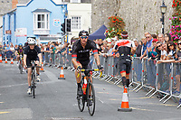 Pictured: Gareth Thomas during the last mile of the cycle race. Sunday 15 September 2019<br /> Re: Ironman triathlon event in Tenby, Wales, UK.