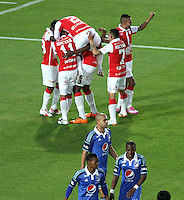 BOGOTA -COLOMBIA, 13- SEPTIEMBRE-2014.  Yerry Mina  de Independiente  Santa Fe  celebra su gol contra Millonarios   durante partido   de La Liga Postobón  novena fecha 2014-2. Estadio  Nemesio Camacho El Campin   / Yerry Mina  of Independiente Santa Fe celebrates his goal against   Millonarios  during La Liga match Postobón ninth date 2014-2.  Nemesio Camacho El Campin stadium . Photo: VizzorImage / Felipe Caicedo / Staff
