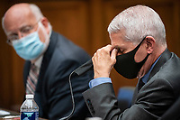 Robert Redfield, director of the Centers for Disease Control and Prevention (CDC), left, and Anthony Fauci, director of the National Institute of Allergy and Infectious Diseases, testify before the House Energy and Commerce Committee in Washington, D.C., U.S., on Tuesday, June 23, 2020. Trump administration health officials will tell lawmakers that their agencies are preparing for a flu season that will be complicated by the coronavirus pandemic. <br /> Credit: Sarah Silbiger / Pool via CNP/AdMedia