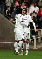 ATTENTION SPORTS PICTURE DESK<br /> Pictured: Jordi Gomez of Swansea (R) celebrating his goal with team mate and fellow double scorer Jason Scotland (L).<br /> Re: Coca Cola Championship, Swansea City FC v Doncaster Rovers at the Liberty Stadium. Swansea, south Wales, Saturday 21 February 2009<br /> Picture by D Legakis Photography / Athena Picture Agency, Swansea 07815441513