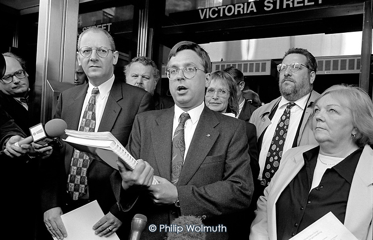 Councillor Andrew Dismore, leader of the Labour Group on Westminster City Council, announces the findings of the District Auditor's final report into the 'Homes for Votes' scandal.  With him are Councillors Peter Bradley, Madge Cavalla, Barry Taylor and Jill Selbourne.  City Hall, Victoria, London.