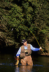 Chris with a brown trout on Fishing Creek, PA