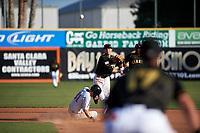 San Jose Giants second baseman Orlando Garcia (21) makes a throw to first base over Jake McCarthy (31) during a California League game against the Visalia Rawhide on April 13, 2019 at San Jose Municipal Stadium in San Jose, California. Visalia defeated San Jose 4-2. (Zachary Lucy/Four Seam Images)