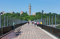 People enjoy the view on the High Bridge leading to the Water Tower in Highbridge Park in Manhattan in New York City.