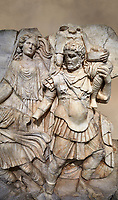 Detail of a Roman Sebasteion relief  sculpture of Aineas' flight from Troy, Aphrodisias Museum, Aphrodisias, Turkey.  <br /> <br /> Aineas in armour carries his aged farther Anchises on his shoulders and leads his young son Lulus by his hand. They are fleeing from the sack of Troy. The figure floating behind is Aphrodite, Aineas' mother: she is helping their escape. Old Anchises carries a round box that held images of Troy's ancestral gods.