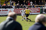 Southport fans in the covered enclosure watching their team (in their change kit of all-white) taking on Harrogate Town at Wetherby Road, Harrogate. The Conference North match was won 3-2 by Southport, a result which kept the Sandgrounders on course for top spot in the division while Harrogate Town remained bottom.