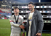 2nd January 2021   Ulster vs Munster <br /> <br /> Ethan McIlroy receives his Player Of The Match Award from Ulster Captain Sam Carter after the PRO14 Round 10 clash between Ulster Rugby and Munster Rugby at the Kingspan Stadium, Ravenhill Park, Belfast, Northern Ireland. Photo by John Dickson/Dicksondigital
