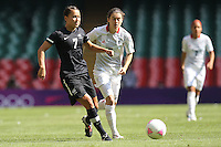 Ali RILEY of New Zealand and Karen CARNEY of Great Britain - Great Britain Women vs New Zealand Women - Womens Olympic Football Tournament London 2012 Group E at the Millenium Stadium, Cardiff, Wales - 25/07/12 - MANDATORY CREDIT: Gavin Ellis/SHEKICKS/TGSPHOTO - Self billing applies where appropriate - 0845 094 6026 - contact@tgsphoto.co.uk - NO UNPAID USE.