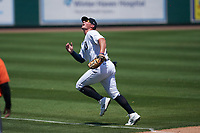 Detroit Tigers third baseman Spencer Torkelson (19) makes a play on a foul ball during a Minor League Spring Training game against the Baltimore Orioles on April 14, 2021 at Joker Marchant Stadium in Lakeland, Florida.  (Mike Janes/Four Seam Images)