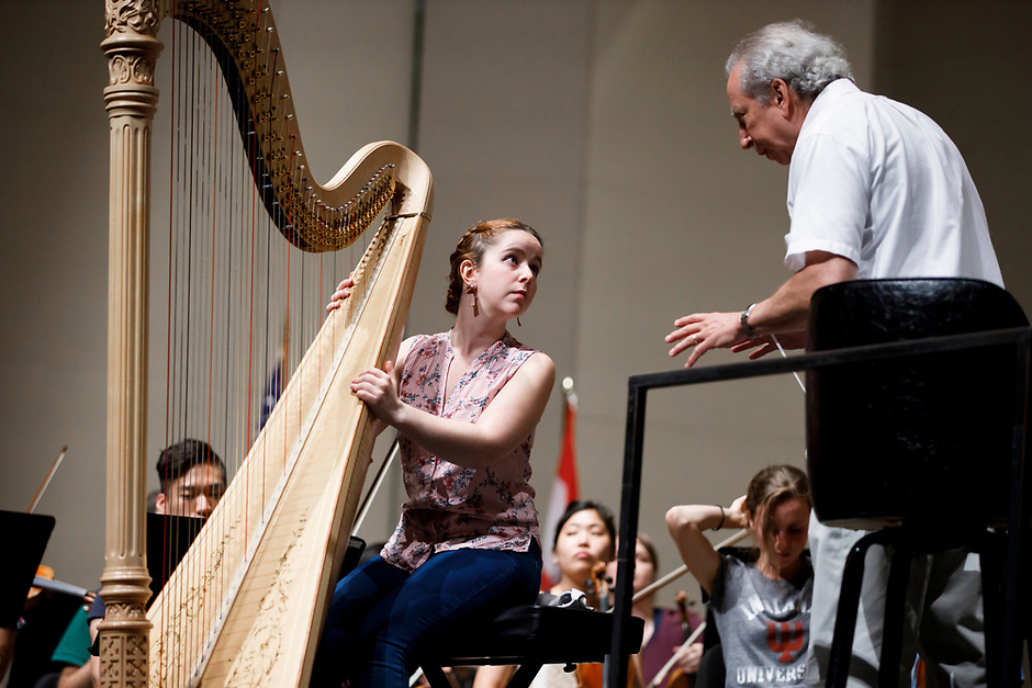 Melanie Laurent from France speaks with conductor Arthur Fagen during an orchestra rehearsal for the Final Stage concert at the 11th USA International Harp Competition at Indiana University in Bloomington, Indiana on Friday, July 12, 2019. (Photo by James Brosher)