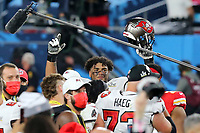 7th February 2021, Tampa Bay, Florida, USA;  2021 Buccaneers first round pick Tristan Wirfs raises his hand and helmet in joy after the Super Bowl LV game between the Kansas City Chiefs and the Tampa Bay Buccaneers on February 7, 2021 at Raymond James Stadium