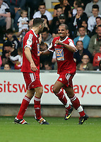 Pictured: Junior Harvey (R) celebrating one of his goals. Sunday, 01 June 2014<br /> Re: Celebrities v Celebrities football game organised by Sellebrity Scoccer, in aid of Swansea City Community Trust, at the Liberty Stadium, south Wales.