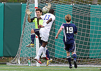HYATTSVILLE, MD - OCTOBER 26, 2012:  Arion Sobers-Assue (13) of DeMatha Catholic High School heads past Luke Duffy (22) of St. Albans to score the first goal during a match at Heurich Field in Hyattsville, MD. on October 26. DeMatha won 2-0.