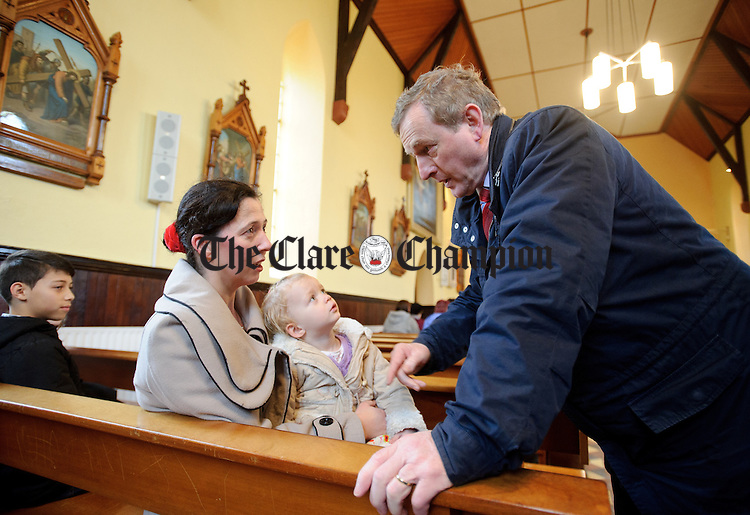 Enda Kenny, Taoiseach chatting with Yvonne Mc Namara in Kilbaha church ahead of Sunday Mass during his visit to Loop Head to launch the Fine Gael tourism initiative. Photograph by John Kelly.