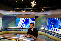 A news anchor at Teletsentr in Ufa, Bashkortostan, delivers news in the native Bashkir language.