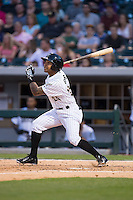 Leury Garcia (24) of the Charlotte Knights follows through on his swing against the Norfolk Tides at BB&T BallPark on April 9, 2015 in Charlotte, North Carolina.  The Knights defeated the Tides 6-3.   (Brian Westerholt/Four Seam Images)
