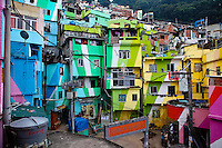 Colorful houses at Favela Santa Marta, the first Rio de Janeiro favela to have an UPP in 2008 ( Pacifying Police Unit ). English signs indicating the location of attractions are posted throughout the community, samba schools are open, and viewing stations have been constructed so tourists can take advantage of Rio de Janeiro's vista.