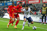 SWANSEA, WALES - NOVEMBER 12: Sebastian Lletget #17 of the United States moves past Connor Roberts #14 of Wales during a game between Wales and USMNT at Liberty Stadium on November 12, 2020 in Swansea, Wales.
