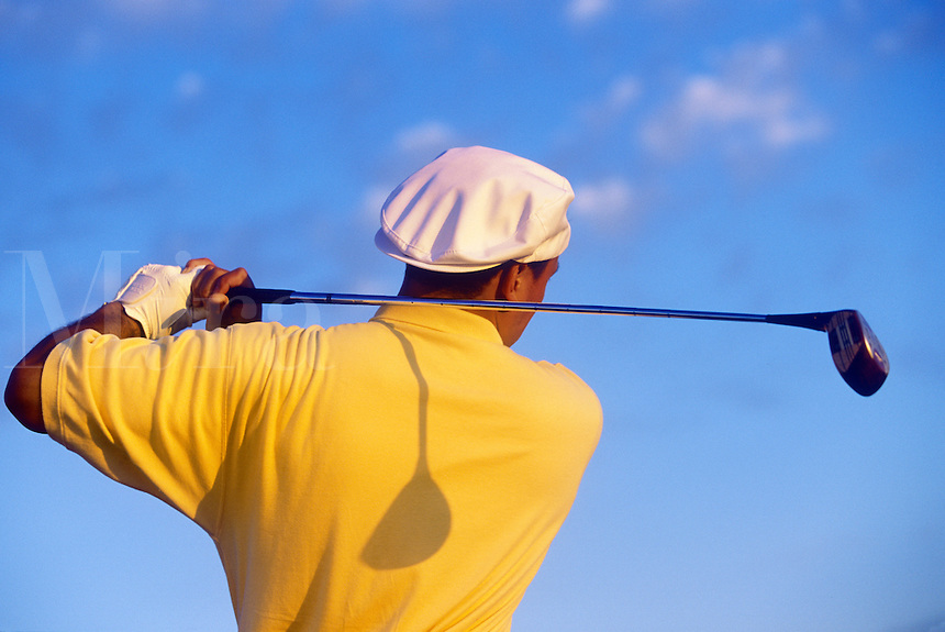 Golfer after driving the ball.